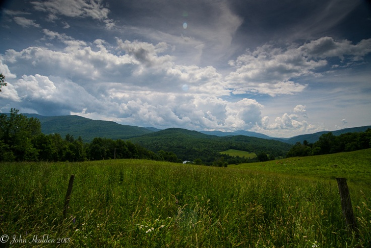 Midday cumulus congestus clouds build above the Green Mountains.