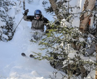 Eric Hanson pops through the trees somewhere in the Mad River Glen woods.