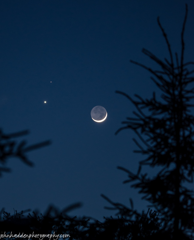 A beautiful convergence of Venus, Mars, and the crescent Moon in this evening's sky